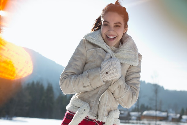 Woman on snowy mountain during winter solstice 2019
