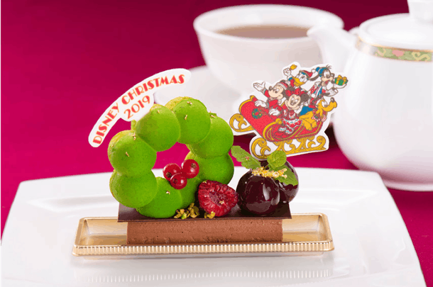 A chocolate mousse dessert decorated with Mickey Mouse and friends is a holiday treat available at the Tokyo Disney Resort.