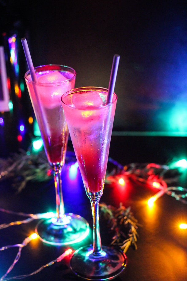 """The Glow Spritz cocktail surrounded by Christmas lights is one of the drinks offered at Disneyland as part of the """"Let It Glow"""" festivities."""