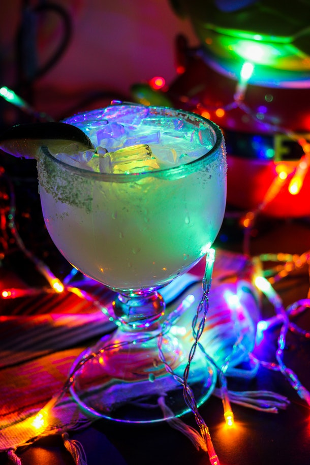 """The glow margarita surrounded by Christmas lights is part of the """"Let It Glow""""-inspired cocktails available at Disneyland for the holidays."""