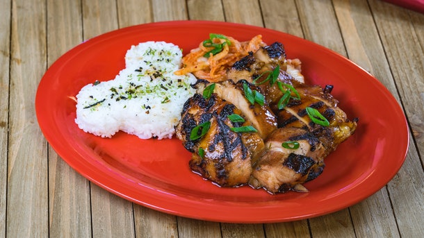The Korean Grilled Chicken dish has Mickey Mouse-shaped rice and is served at Disneyland's Lunar New Year celebration.
