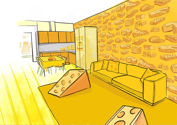 Concept art of the Cheese Suite by Café Rouge shows a block of cheese furniture and cheese throw pillows on the couch.