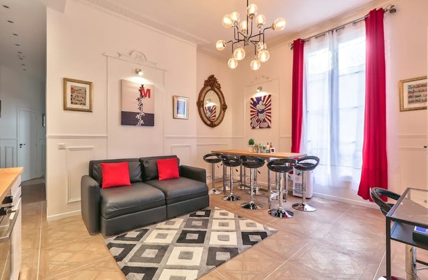 This Mickey Mouse-themed Airbnb in Paris has a leather couch, a big window, and Mickey decor throughout.