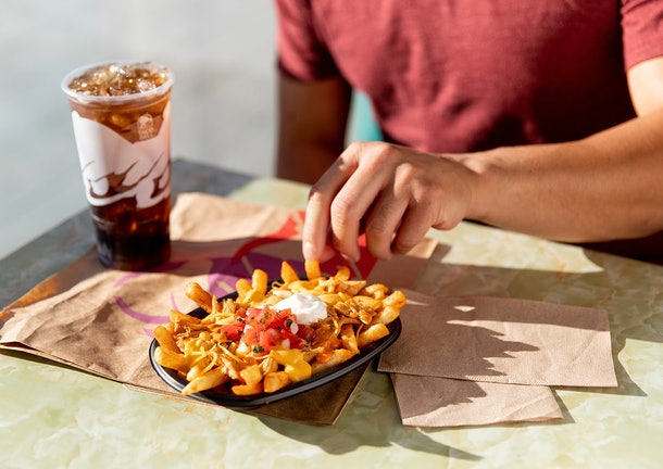Taco Bell's New Buffalo Chicken Nacho Fries are coming to stores on Jan. 30.