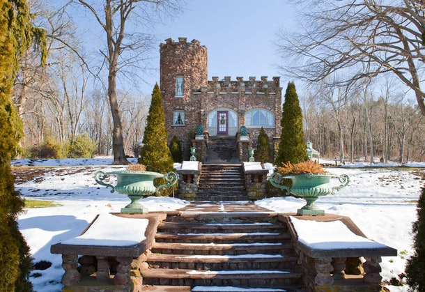 Snow covers a cozy castle in Connecticut that's listed on Airbnb.