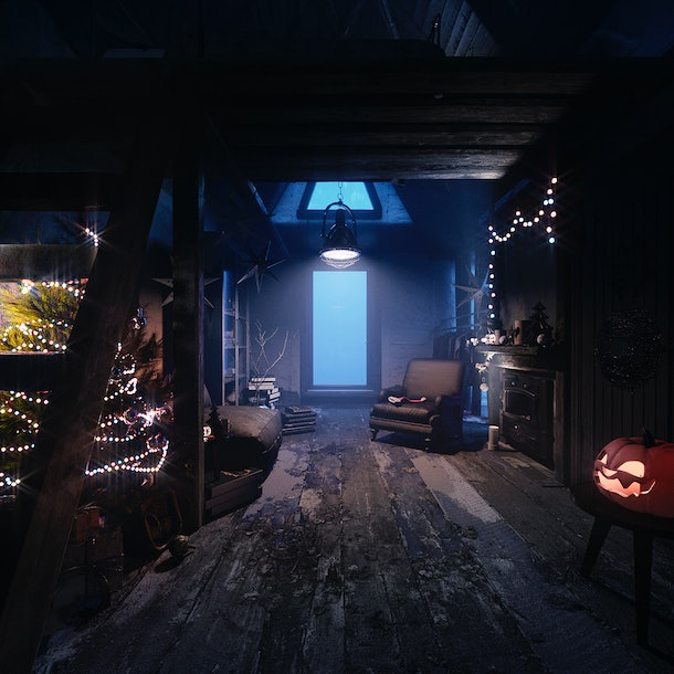 A Jack Skellington-inspired Disney tiny house has wood floors and is decorated with a jack-o-lantern and Christmas tree.