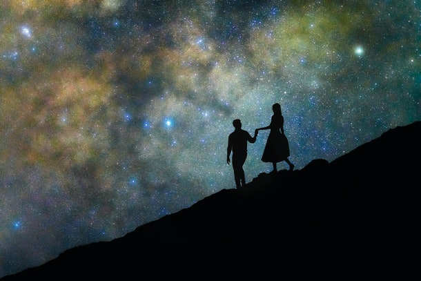 Couple walking in front of stars