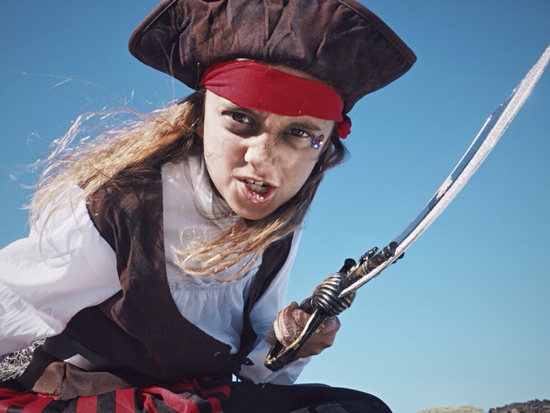 Little girl wearing pirate costume