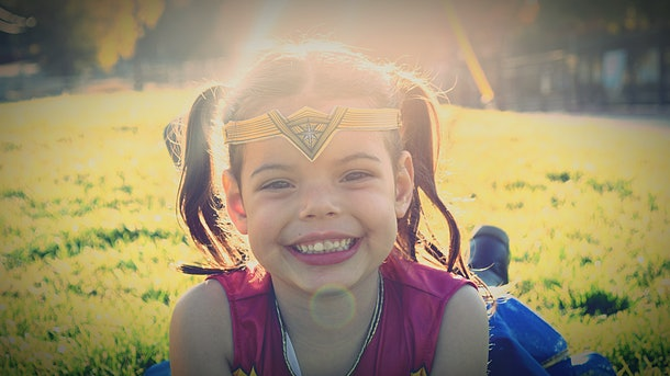 Little girl in superhero costume