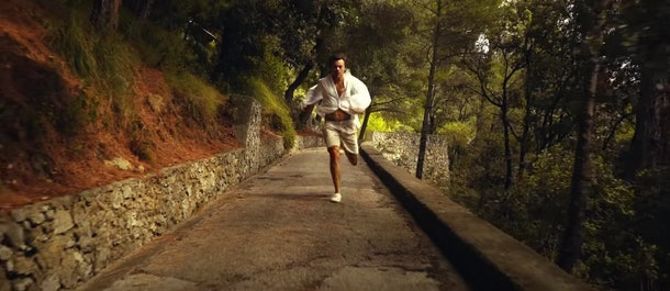 Harry Styles runs on a hiking trail in Italy.