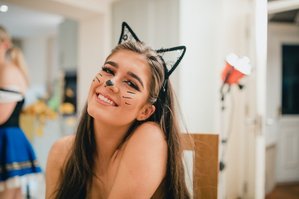 Young woman in cat costume on Halloween