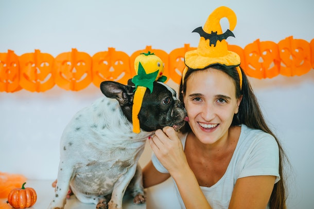 Woman with dog in Halloween costumes