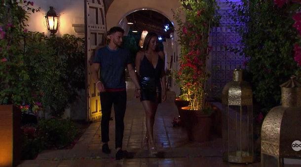 Tayshia Adams and Brendan Morais walking