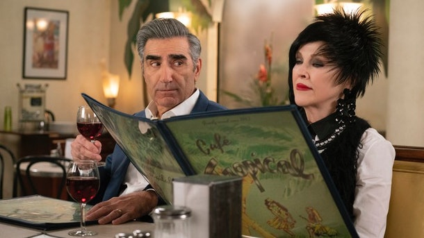 Johnny Rose (Eugene Levy) looks over at Moira Rose (Catherine O'Hara) while sitting at the Cafe Tropical in 'Schitt's Creek.'