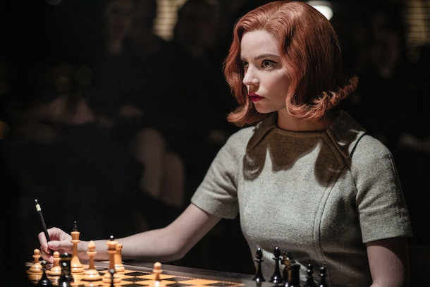 Bath Harmon (Anya Taylor-Joy) writes notes during a chess match in 'The Queen's Gambit.'