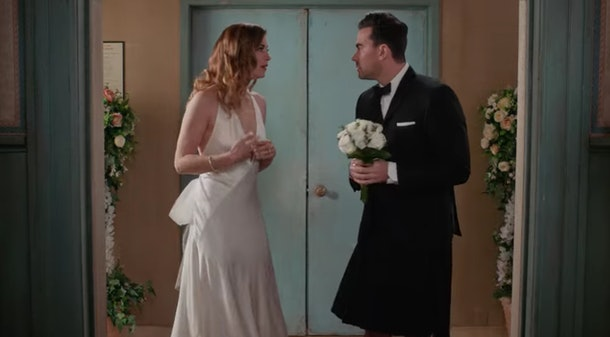 Alexis (Annie Murphy) and David (Dan Levy) are dressed up for David's wedding day on 'Schitt's Creek.'