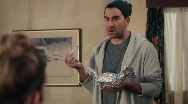 David (Dan Levy) eats leftover cake from a tinfoil swan in 'Schitt's Creek.'