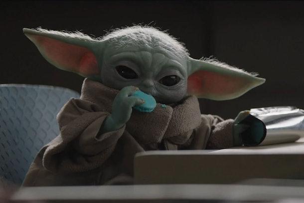 Baby Yoda enjoys a snack in The Mandalorian.