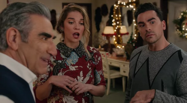 David and Alexis receive gifts from Johnny on Christmas Eve in 'Schitt's Creek.'