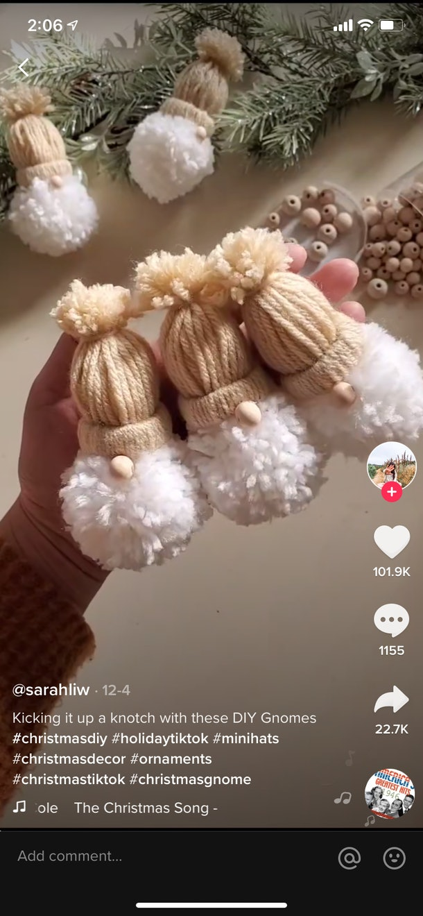 A TikTok crafter uses a paper towel roll and yarn to create adorable Christmas gnomes in a thriftmas video.