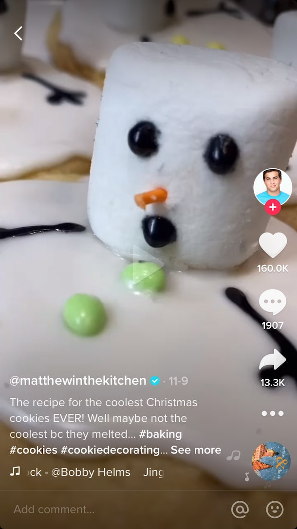 A man shows how to make snowman cookies on TikTok in a baking video.