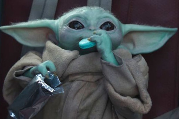 Baby Yoda enjoys some blue cookies on 'The Madalorian.'