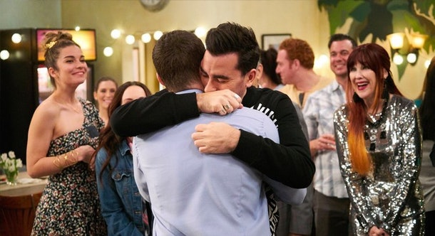David Rose hugs Patrick at a party in 'Schitt's Creek.'