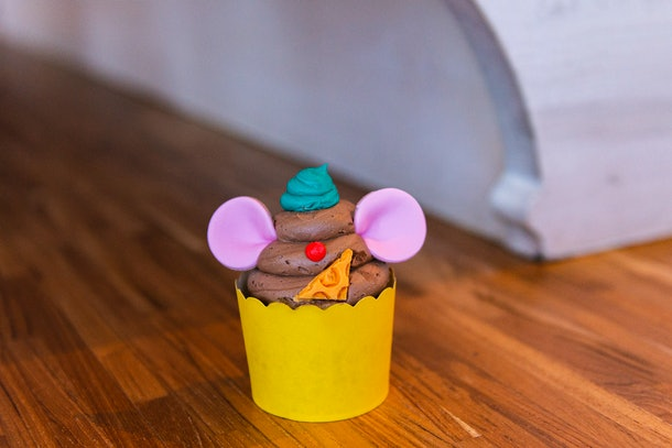 A peanut butter cupcake made to look like Gus Gus from 'Cinderella' sits on a table at Disney World.
