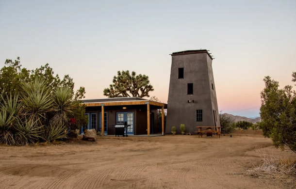 A tower in Joshua Tree is part of a cabin home listed on Airbnb.