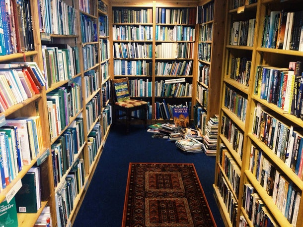 Books fill the shelves of a library that's listed on Airbnb in the UK.