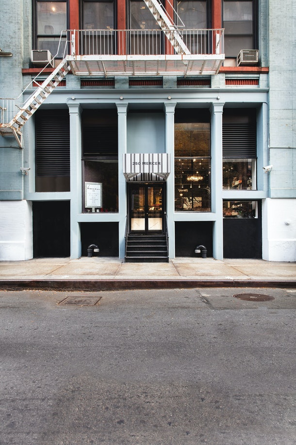 The exterior of Haven Spa NYC features light blue columns and large windows.