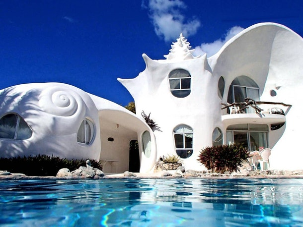 The World Famous Seashell House on Airbnb has a dreamy pool and white exterior that's incredibly bright in the sunlight.