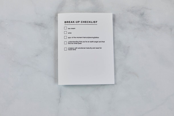 "A note from Small Packages details a ""break-up checklist"" including wine, ice cream, and a spur of the moment tattoo."