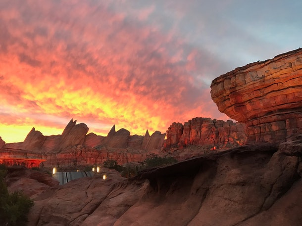 The Cadillac Range mountains at sunset in Cars Land at Disneyland is a great location for pics with your partner.