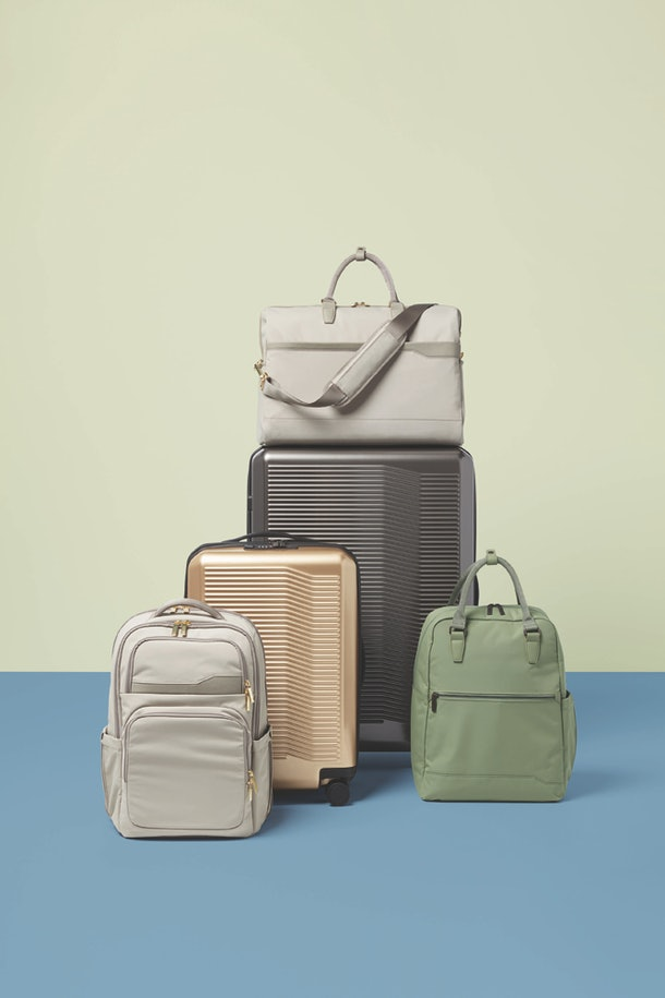 Target's Open Story luggage brand has various pieces like suitcases, a backpack, and weekender bag.