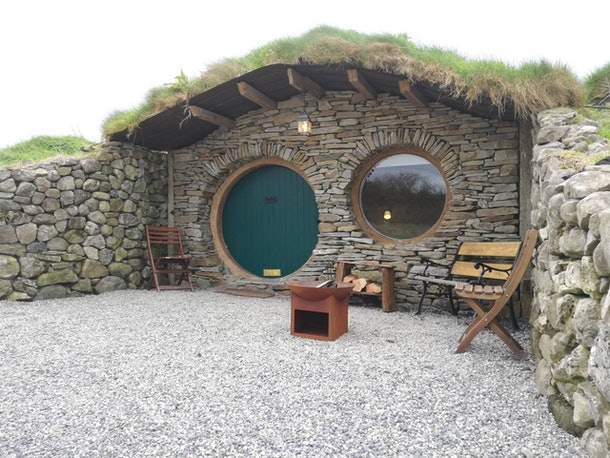 A glamping spot in Castlebar, Ireland is inspired by 'The Hobbit' and has a nice outdoor seating area.
