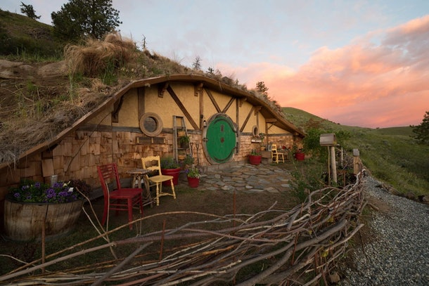 A 'Hobbit' Airbnb in Orondo, Washington is built into the side of a grassy hill and has forest-like details.