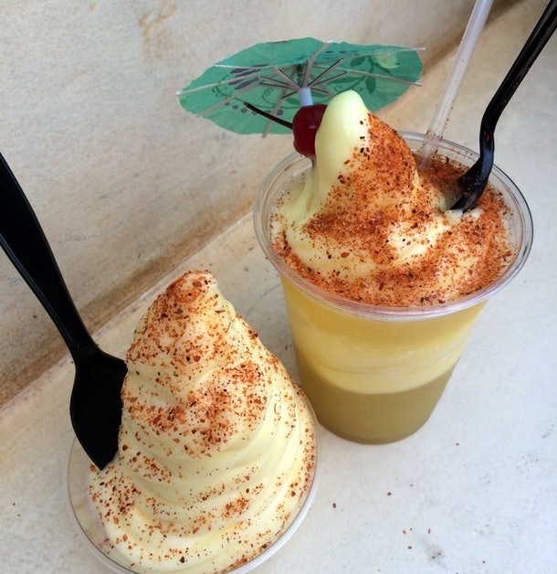 Two dole whips with off the menu tajin seasoning have forks and spoons in them at Disneyland.