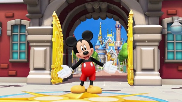 Mickey Mouse stands with his arms opening, welcoming people to Magic Kingdom in the Disney Magic Kingdoms game.