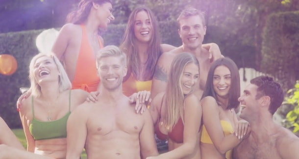 The cast of 'Summer House' sit by the pool at their house in Long Island.