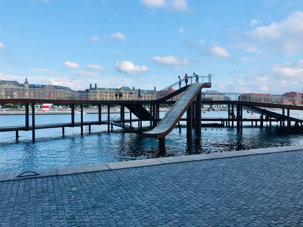 A slide goes into a canal in Copenhagen, Denmark.