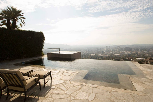 An infinity pool at an Airbnb rental overlooks downtown Los Angeles.
