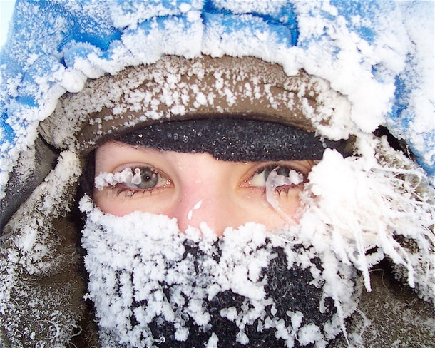 A closeup of musher Blair Braverman covered in ice