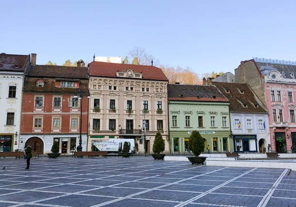 A landscape shot showcases colorful buildings in Brasov, Romania.