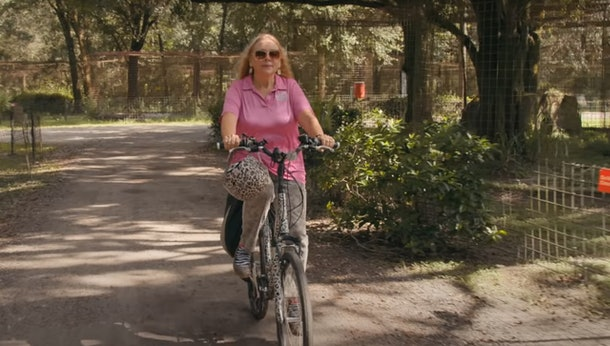 Here are the best 'Tiger King' Zoom backgrounds include Baskin on her leopard print bike.