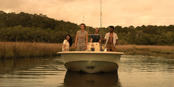 "The teens of Netflix's ""Outer Bank""' cruise in the water on a boat"