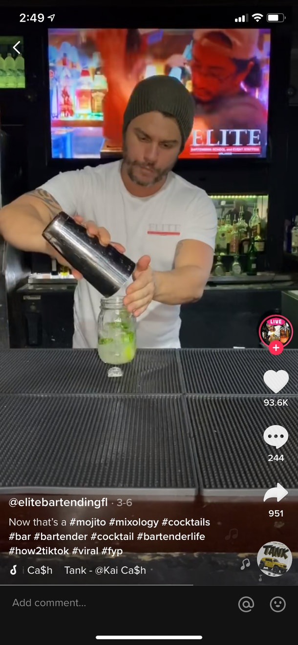 A young bartender brews a fresh mojito in a bar for TikTok.