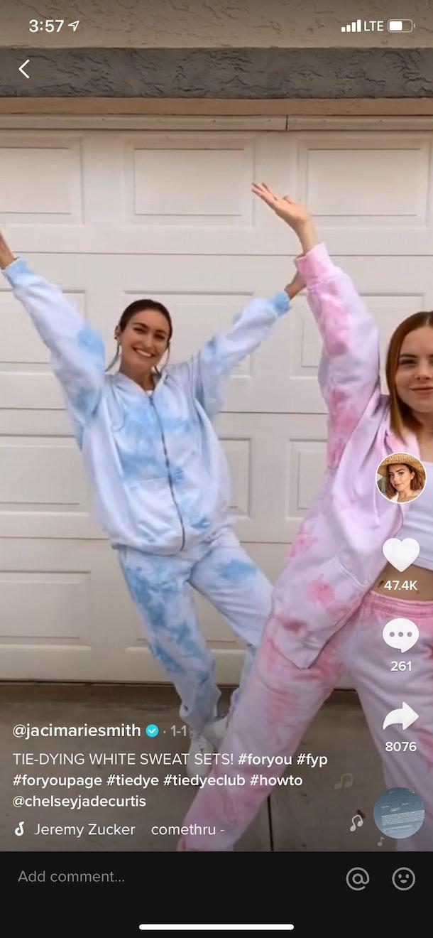 Two best friends match in tie-dye sets in a TikTok video.