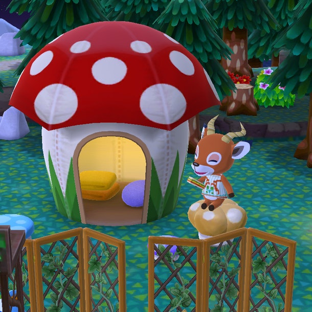 Beau from 'Animal Crossing' sits near a mushroom-shaped tent and eats a sandwich in the video game.