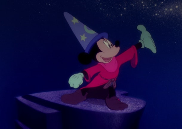 Sorcerer Mickey from 'Fantasia' stands on a rock, conducting the water.